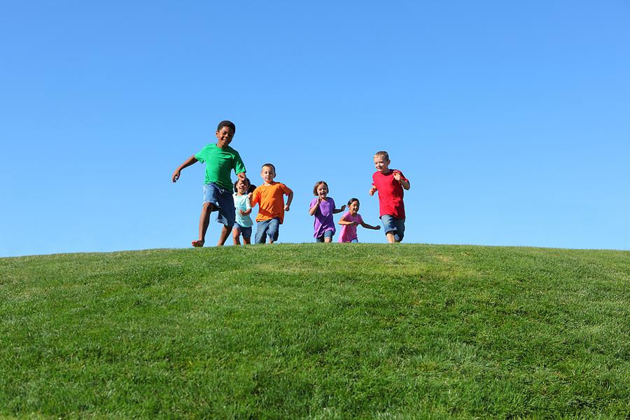 Group of kids running on grass