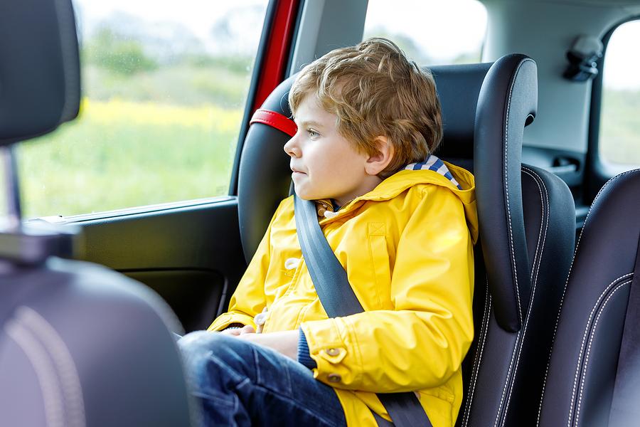 kid boy sitting in car