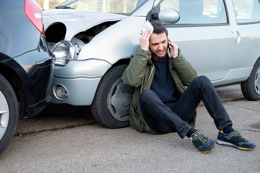 Man Calling First Aid After Car accident