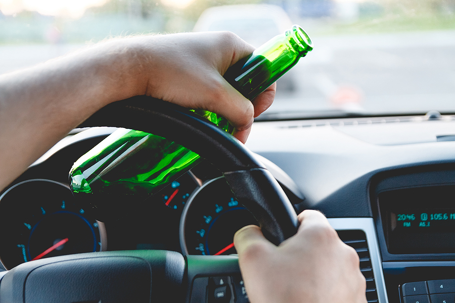 Drunk young man driving a car