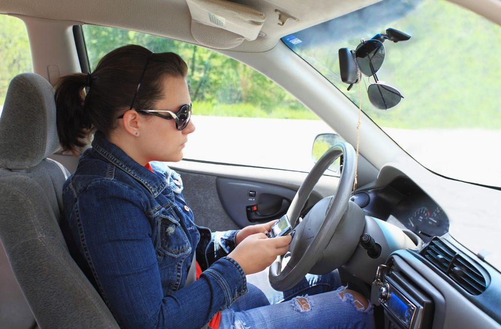 Teen Typing message While Driving