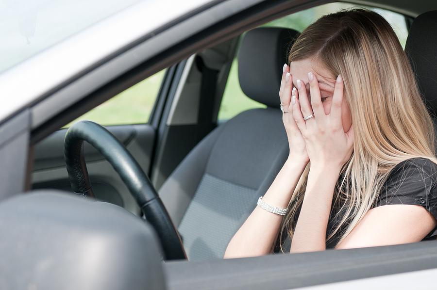 Unhappy Woman In Car
